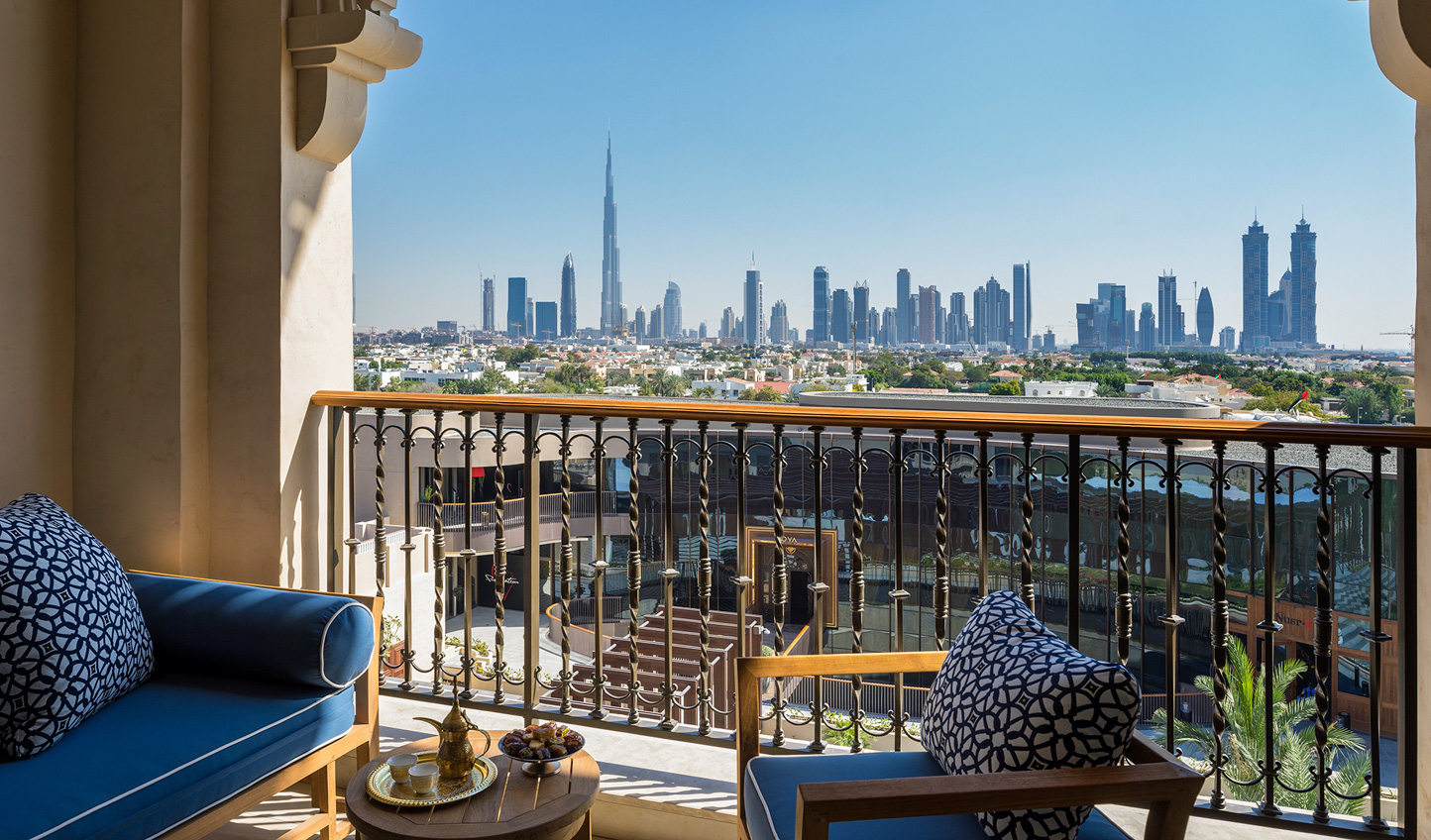 Head out onto your balcony and watch the sun slowly creep up into the sky over the skyline beyond