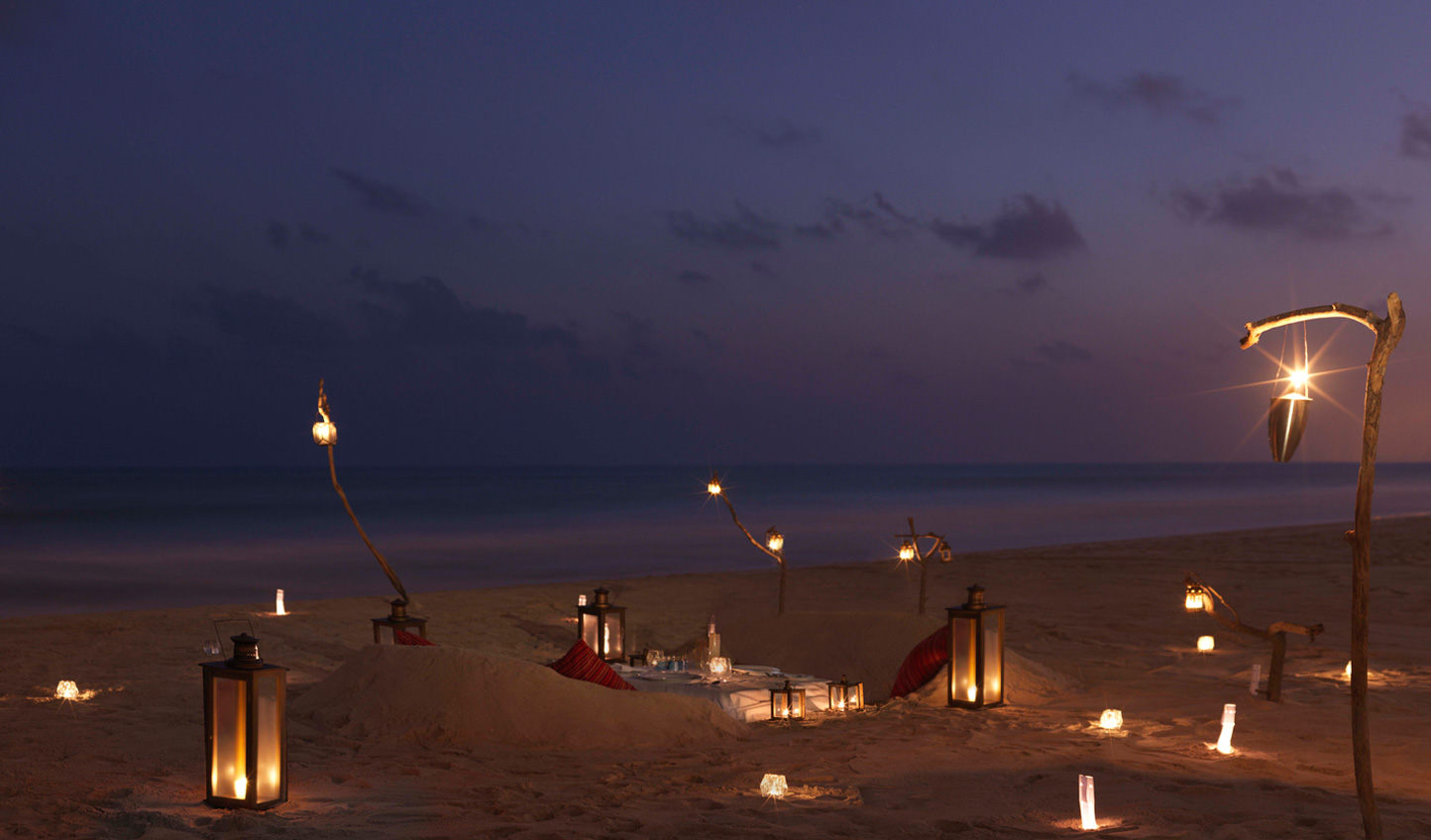 Go for utterly bespoke dining and sit up at a table carved out of sand surrounded only by candlelight