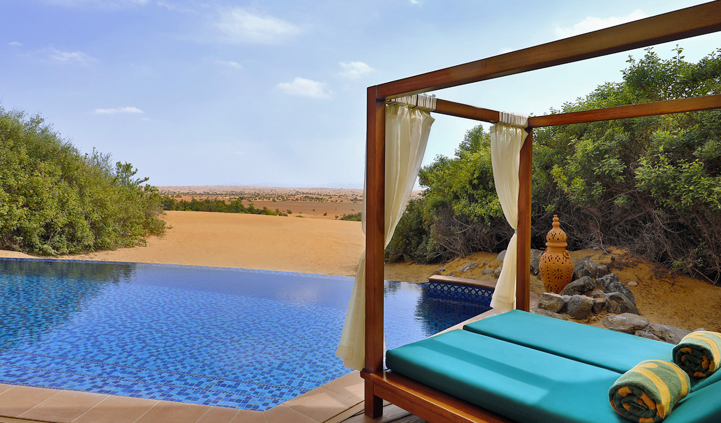 Lounge by your Emirates Suite pool in the middle of the Dubai desert