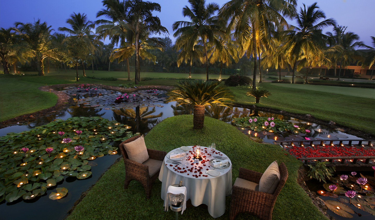 Dine out in the gardens surrounded by the soft scent of tropical flora