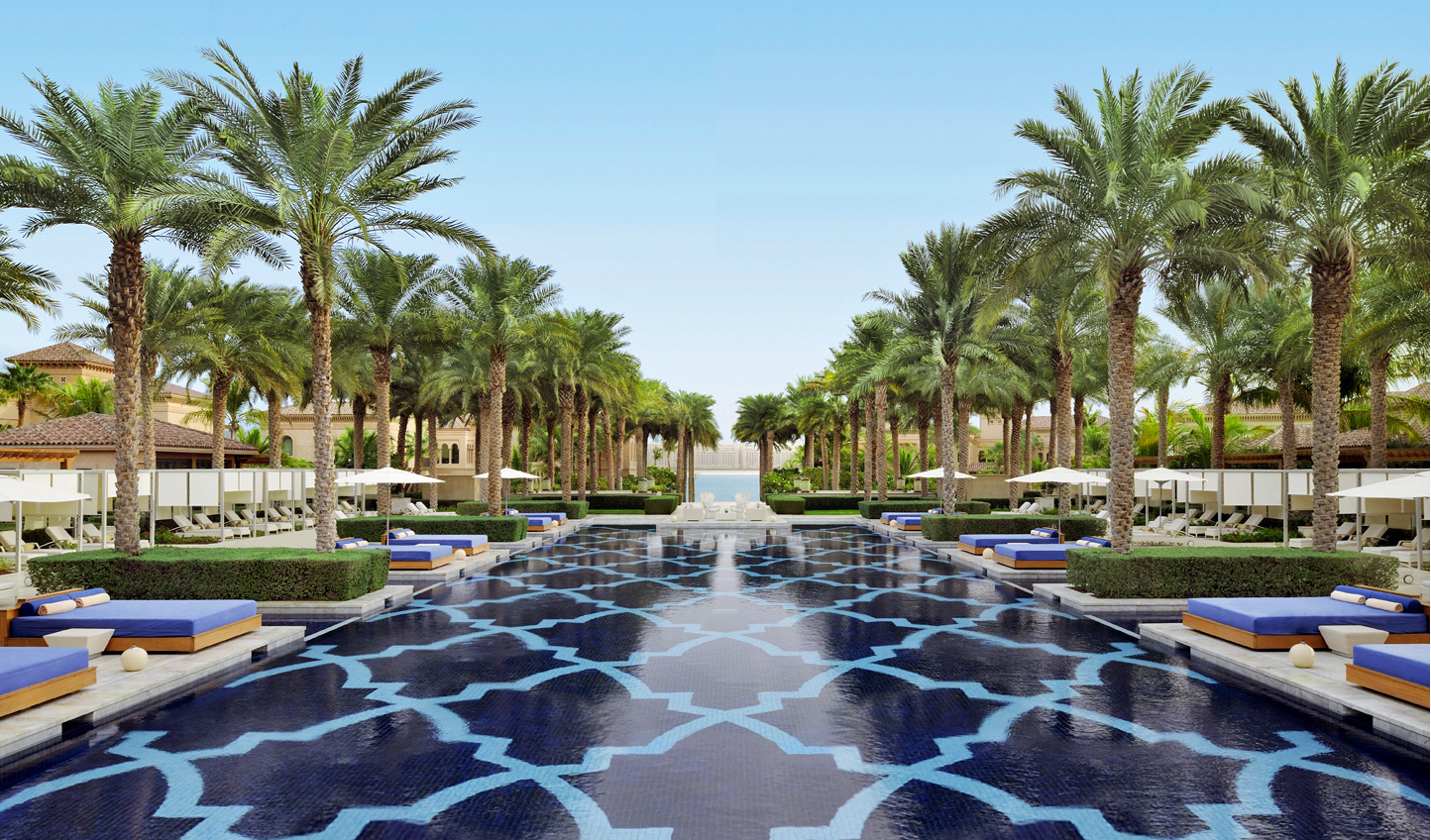 Listen only to the subtle ripple of water as you swim the length of the pool beneath the wavering palm trees