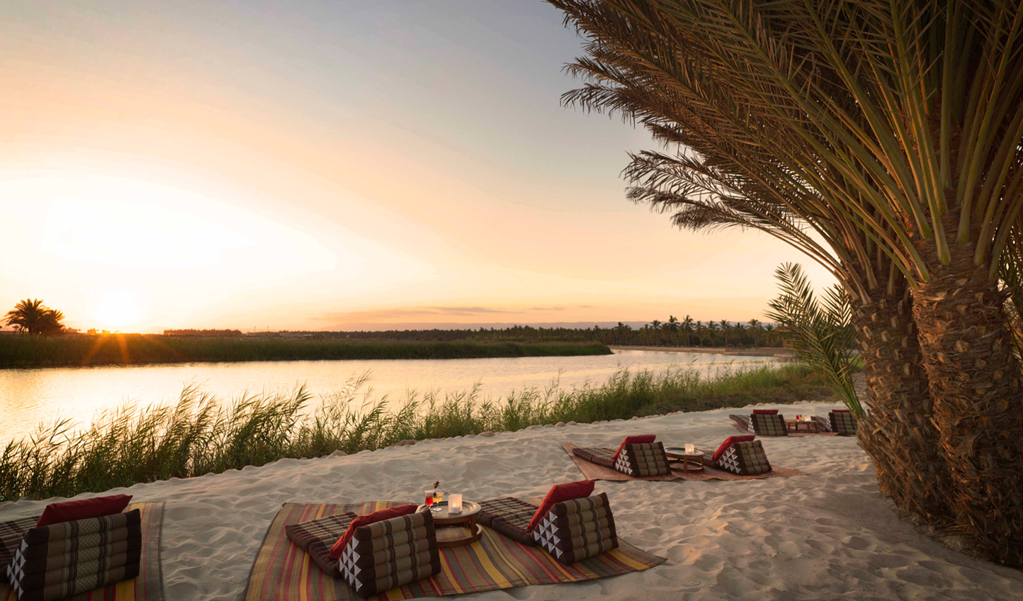 Swap the beach and pool for views of the natural freshwater lagoon at sundown