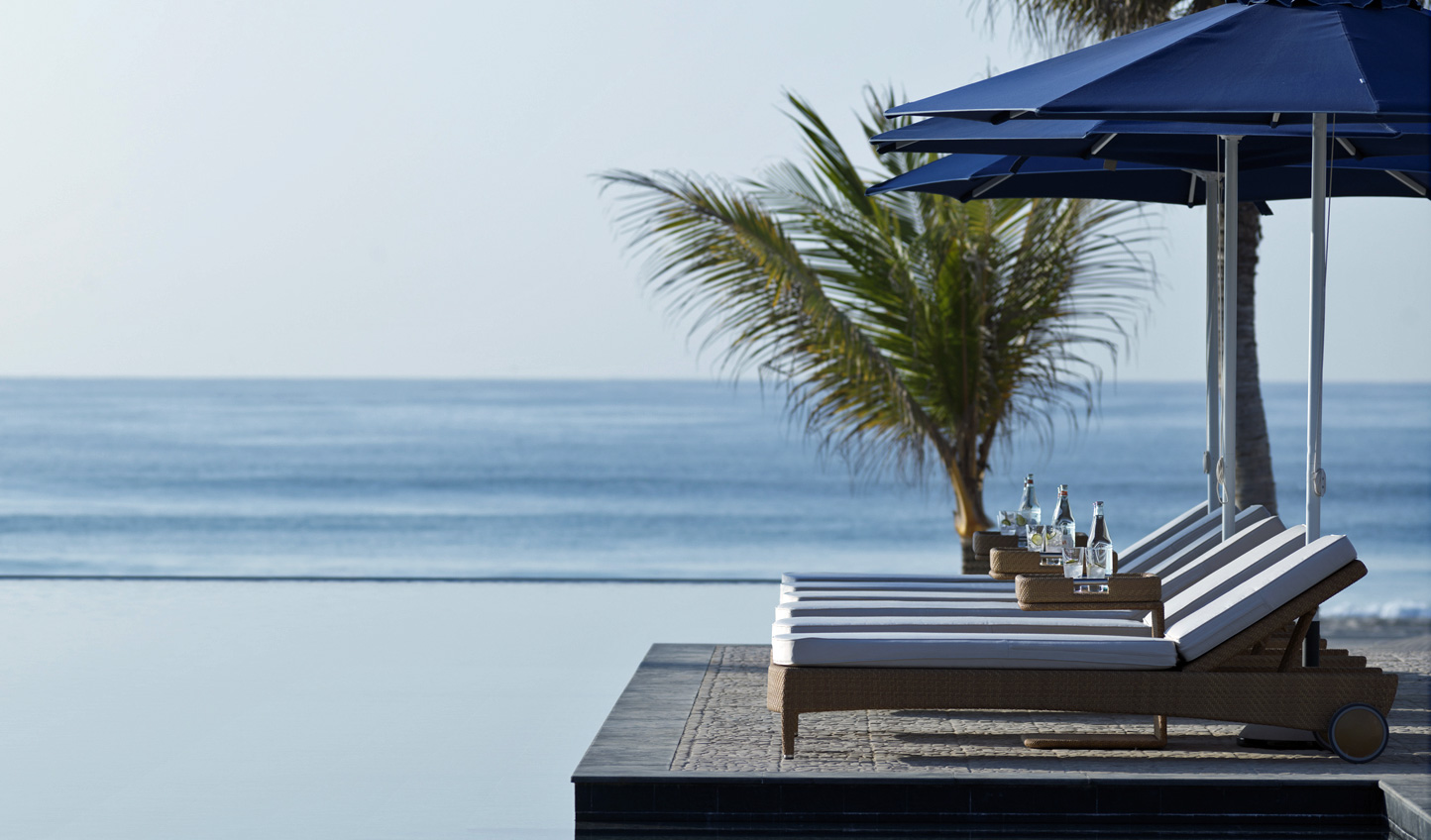 Relax poolside where the infinity pool ends and the Arabian Sea begins