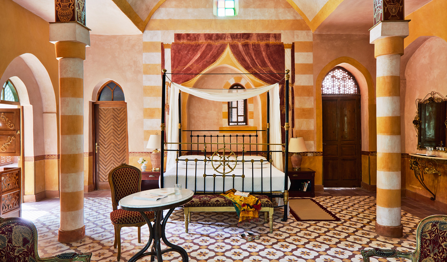 Slumber in a beautiful canopied bed surrounded by handpainted murals