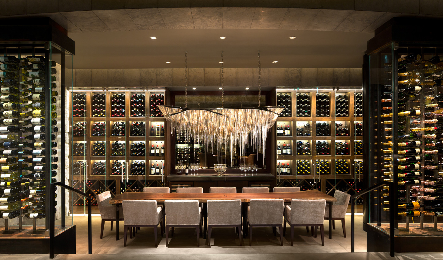 La Cava is an intimate and exclusive wine cellar featuring wall-to-wall cabinets housing 1,000 premium labels