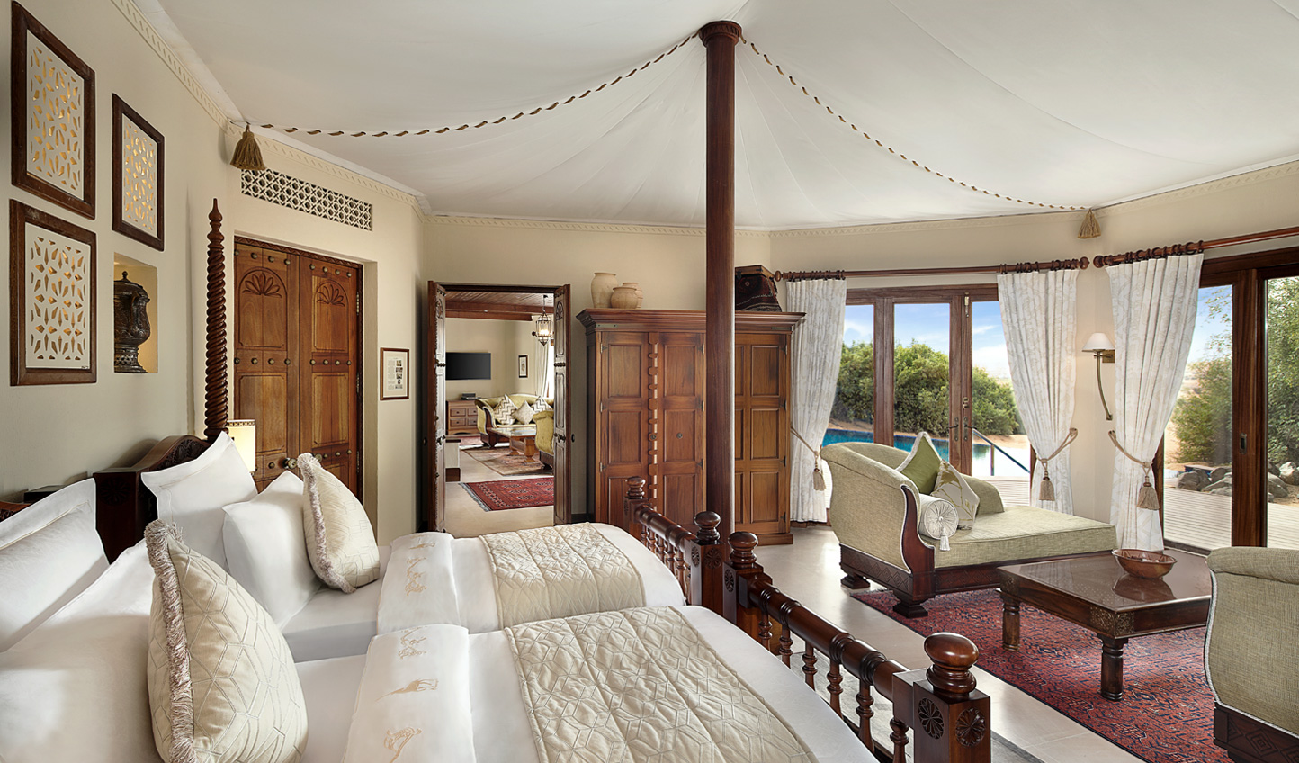 The Emirates guest room exudes Arabian flair with dark-wood furnishings and a canopy ceiling