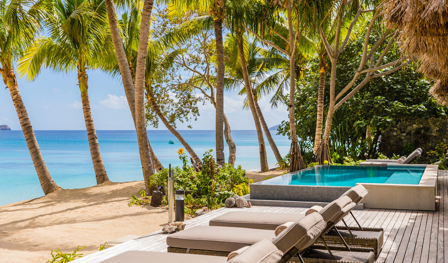 Step from your villa deck straight onto the sand