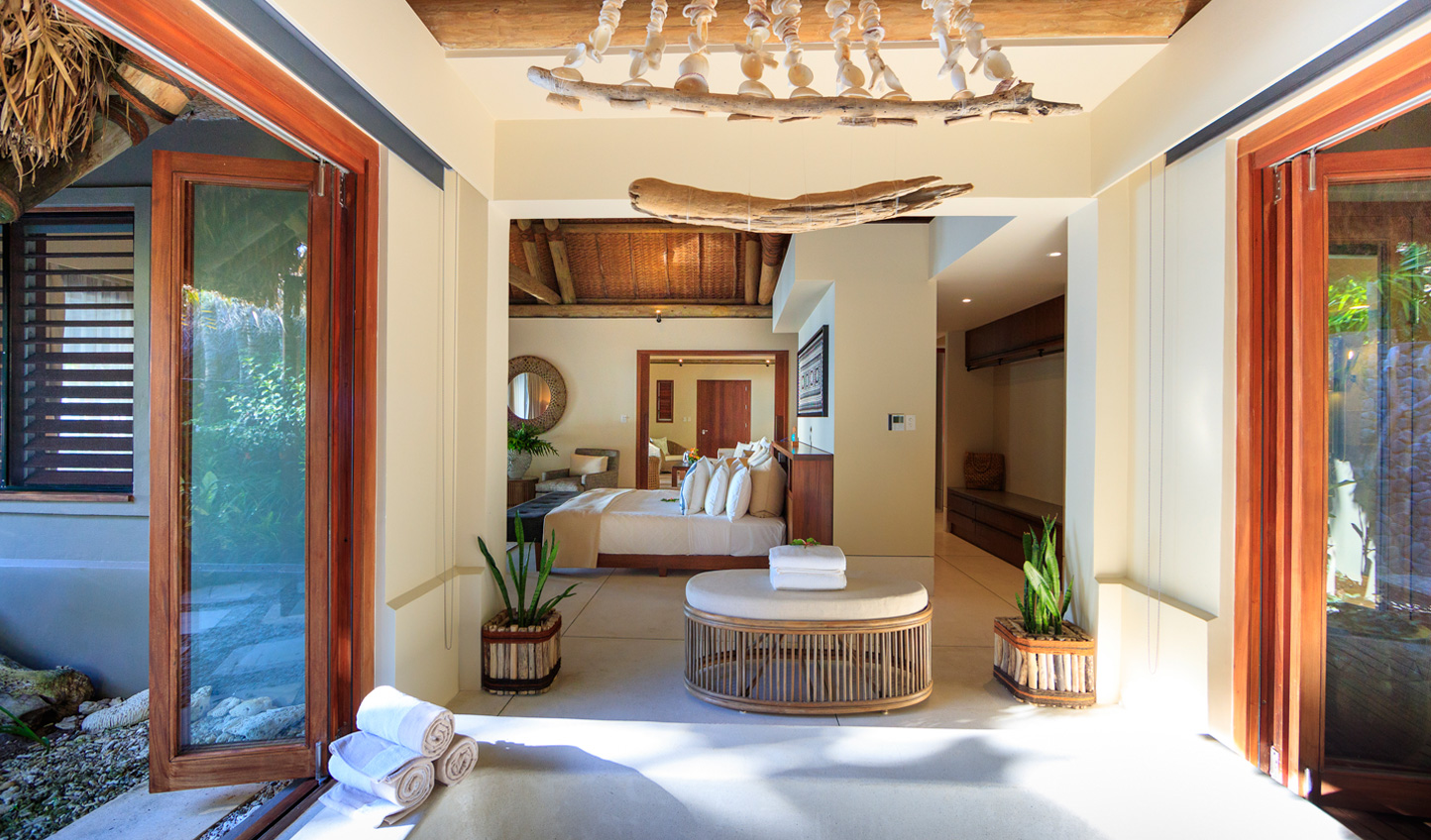 Retreat to your thatched-roof beachfront villa after a day in the sun