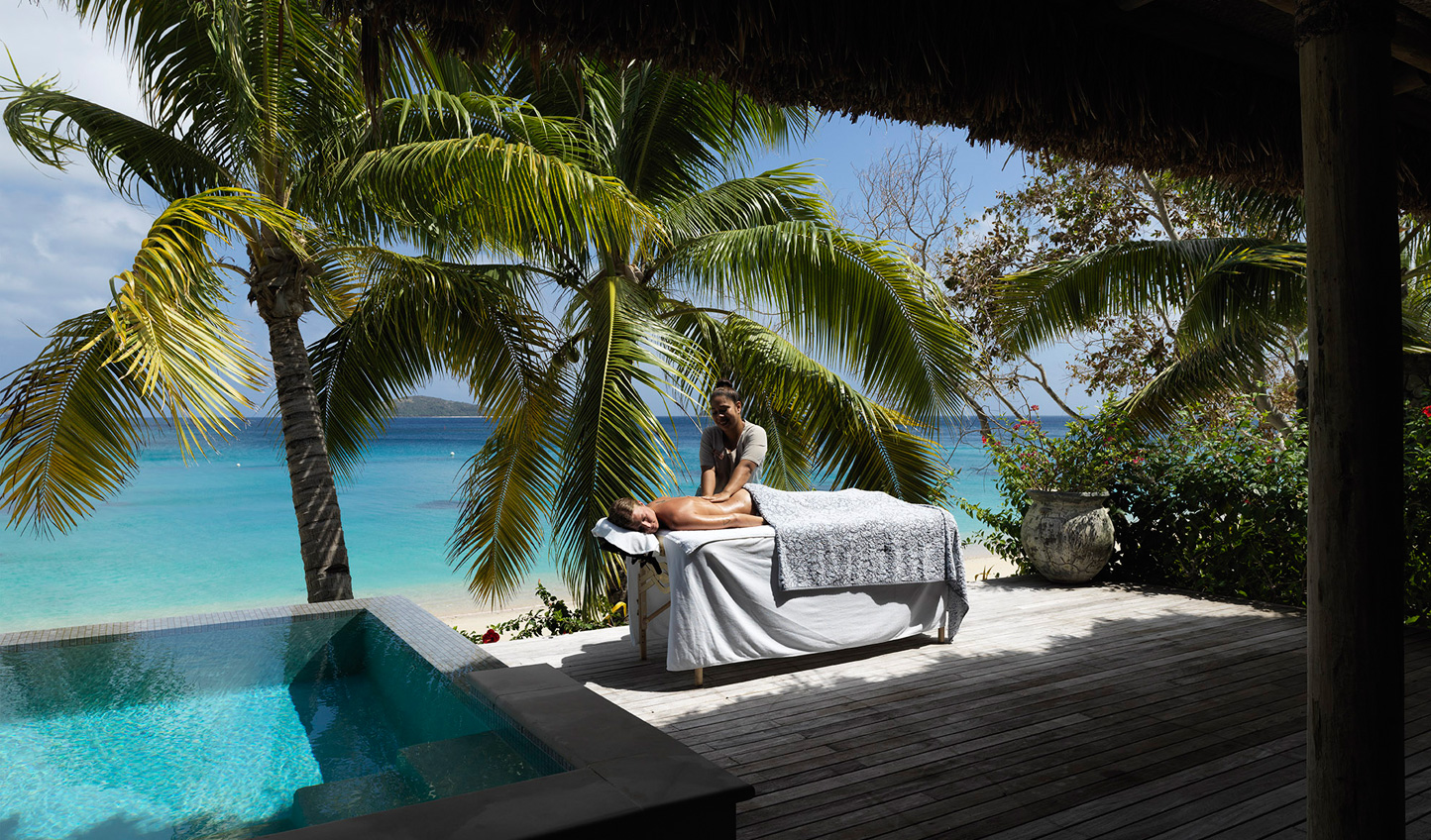 Don't waste a minute of your beachfront villa and have your massage on the deck