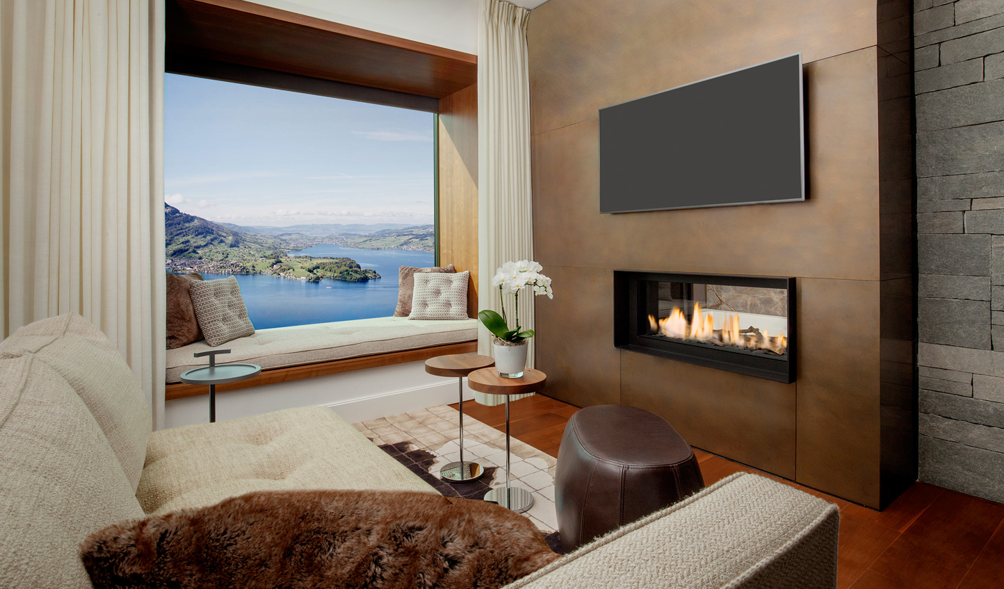Cosy up in one of the gorgeous rooms and suites at Bürgenstock Hotel