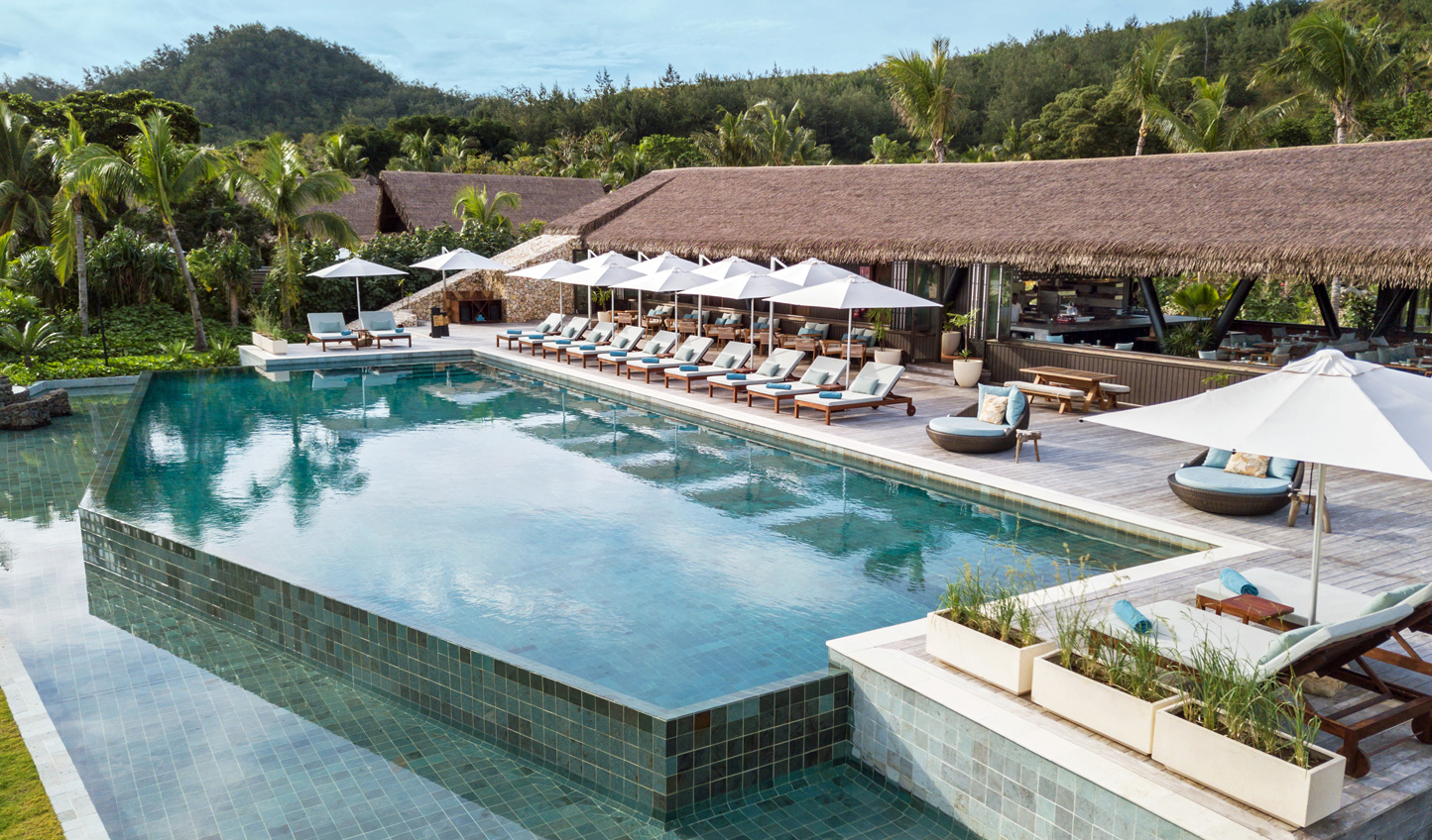Take some time off from adventuring through the islands to relax by the pool
