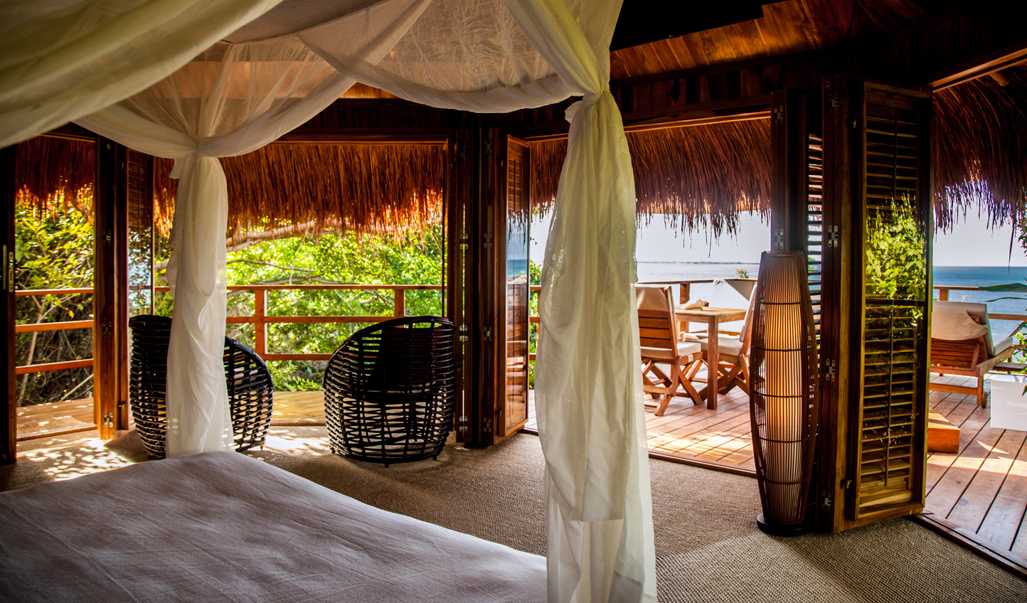 Wake up to  views across the jungle and over the sea
