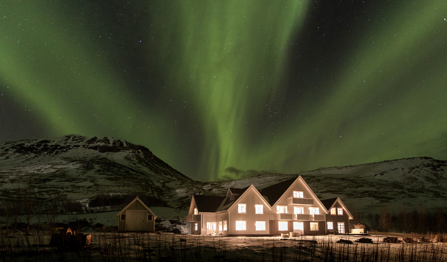 Rest up beneath the flicker of the Northern Lights at Skalakot