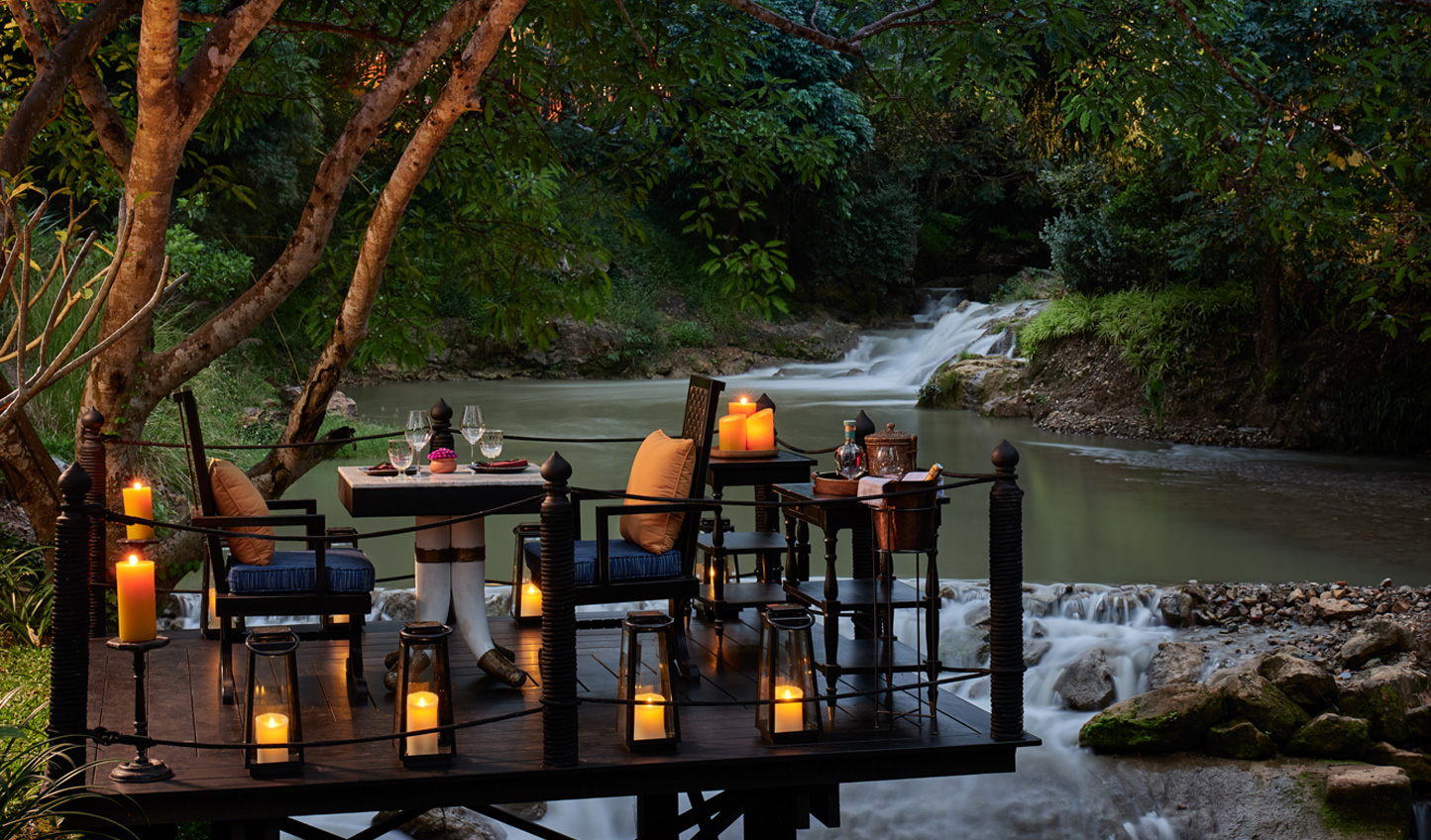 Dine by candlelight amid the romance of the waterfall