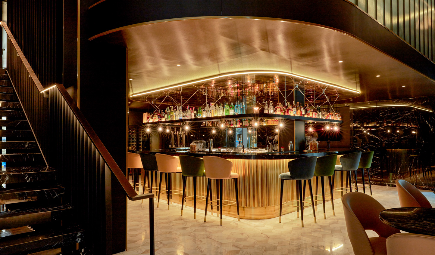 Discover Barcelona's vibrant social scene with a drink at the bar