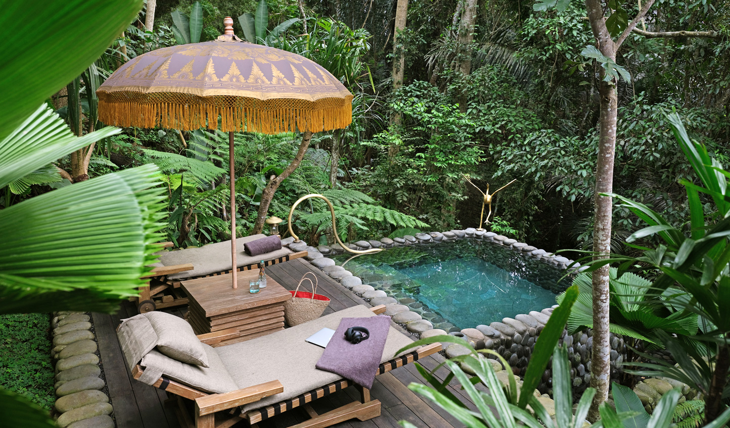 Take a dip in your private pool, ensconced within the jungle