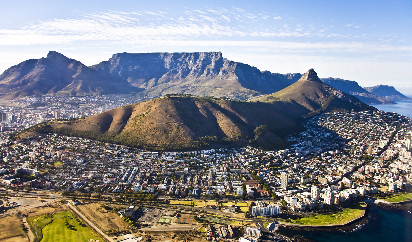 Arrive into sweeping city of Cape Town, bordered by mountains and oceans