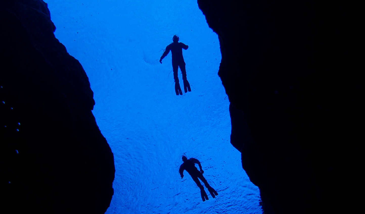 Plunge into the abyss as you snorkel or dive through the Silfra Fissure