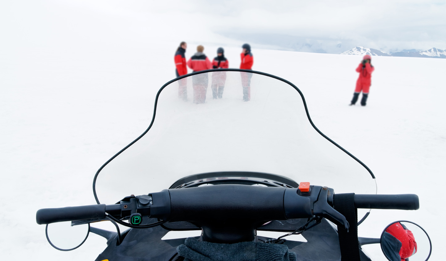 Speed across glaciers on a snowmobile tour