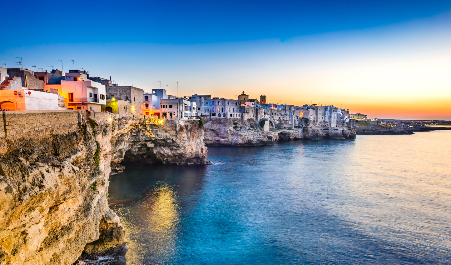 Watch the sun dip down over this picturesque Italian scene