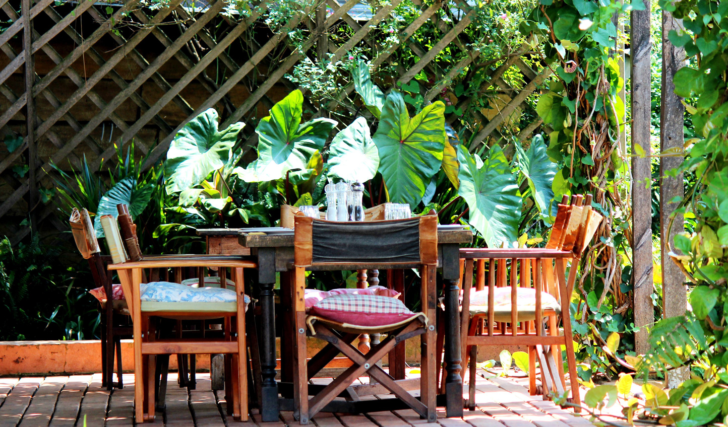 Dine al fresco amid the tropical gardens