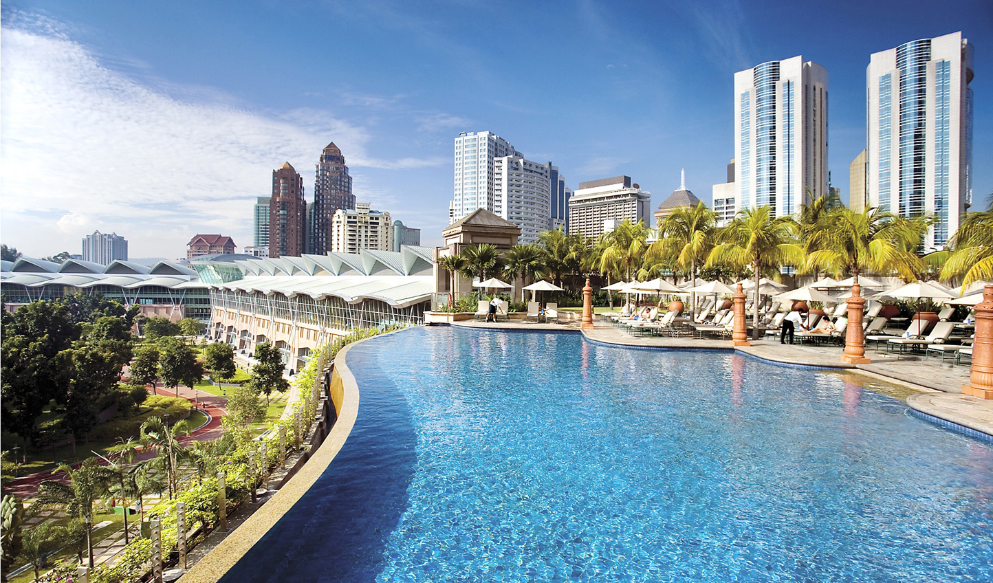 Rest up by the sleek infinity pool at the Mandarin Oriental