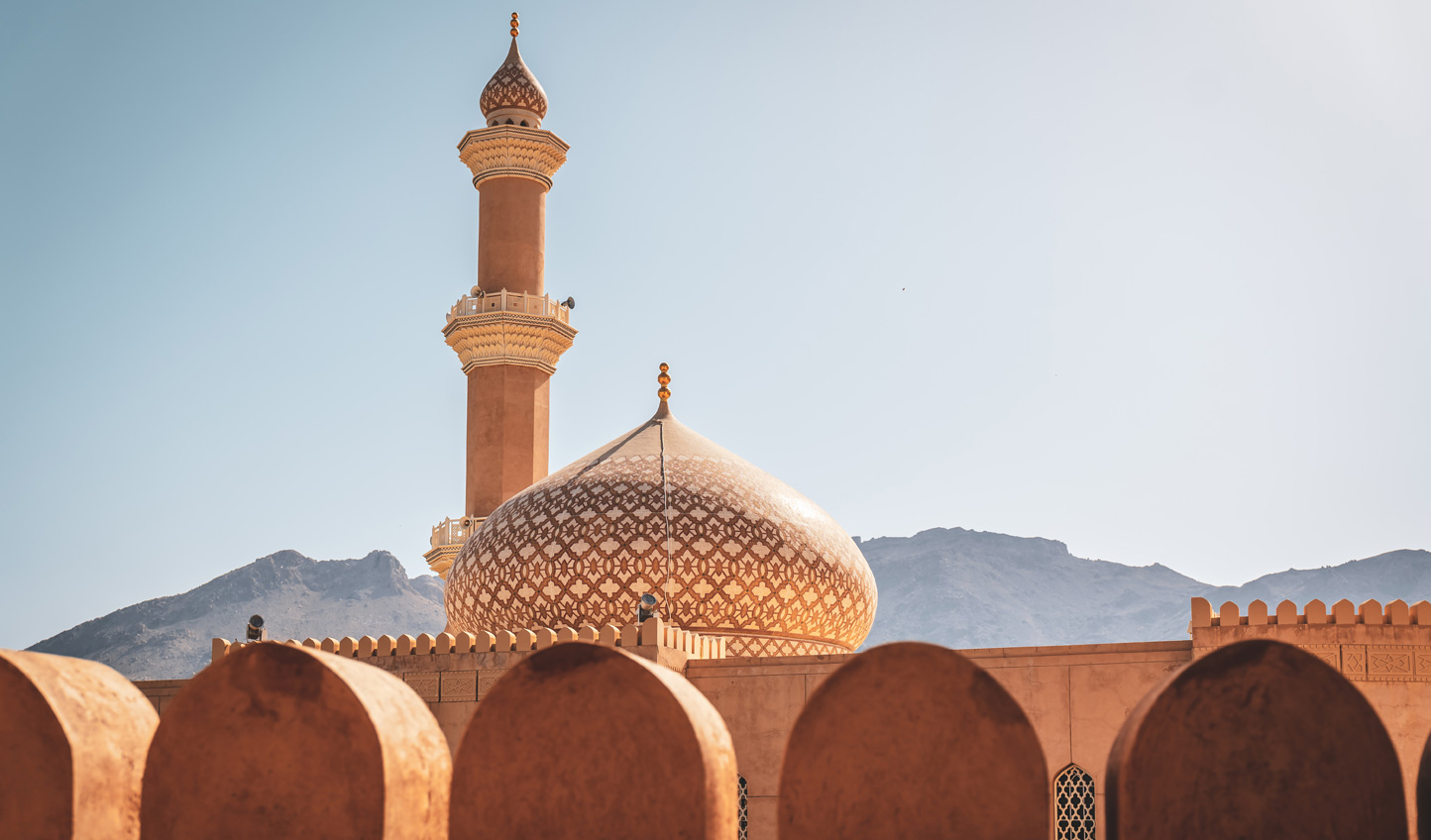 Stunning architecture set against a mountainous backdrop