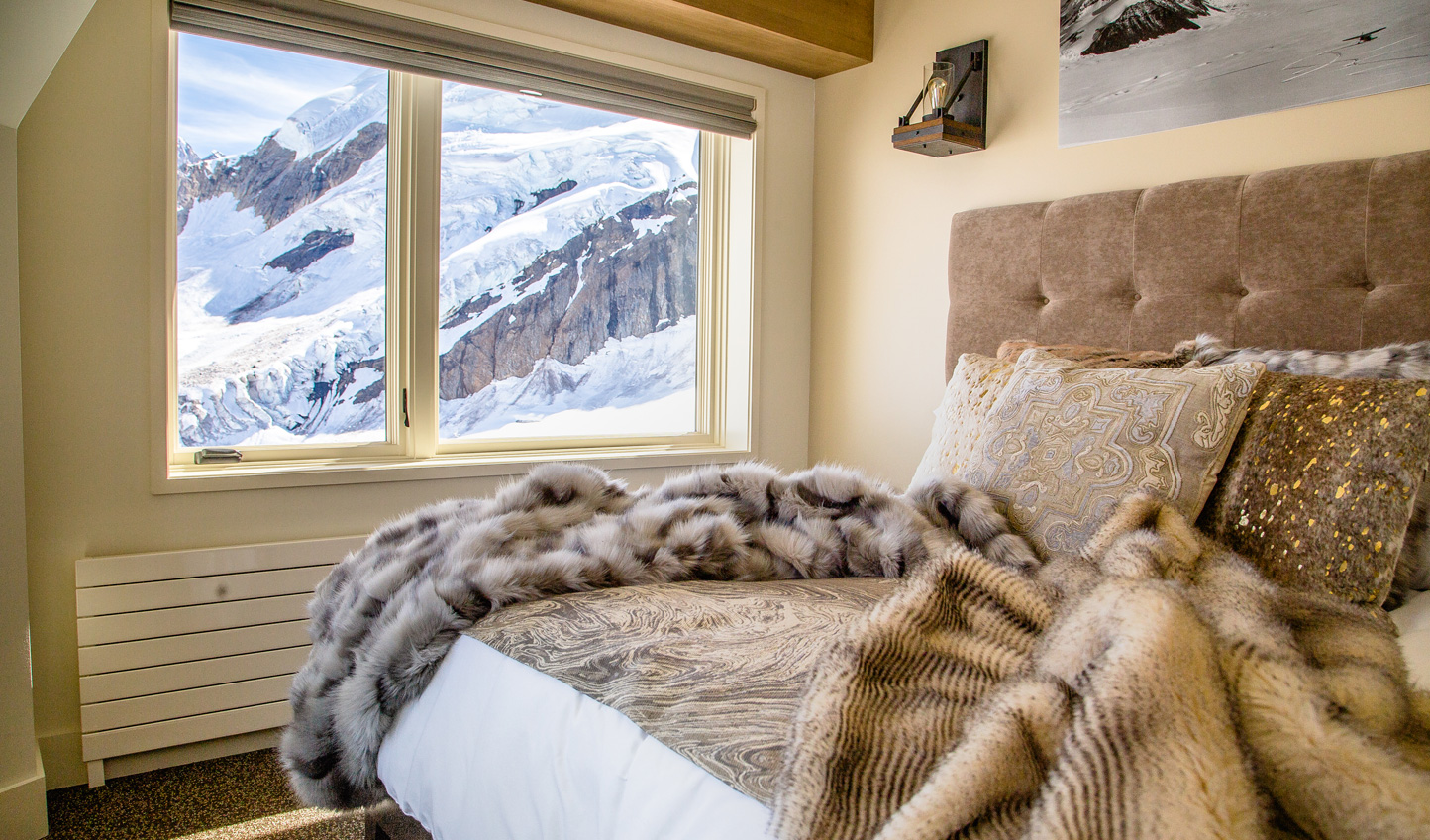 Snuggle up beneath cosy fur throws in your panoramic guestroom