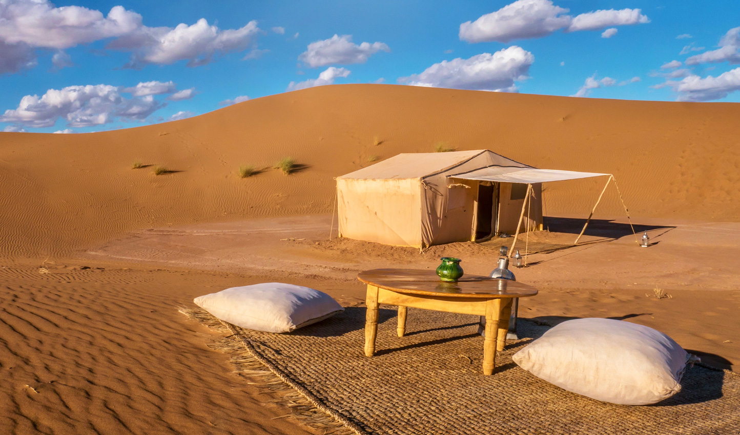 Bed down at your luxurious private camp in the Sahara