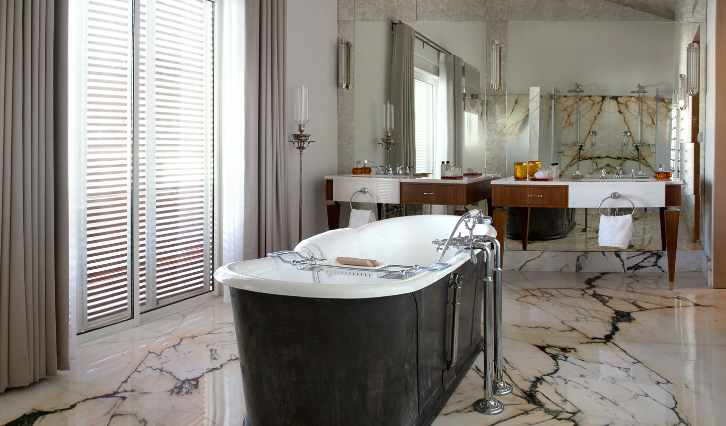 Sink into a luxurious bathtub in the Presidential Suite