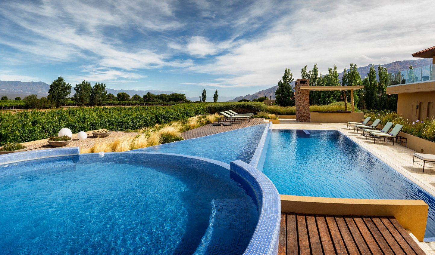 Swimming pools overlook the impressive stretch of vineyards