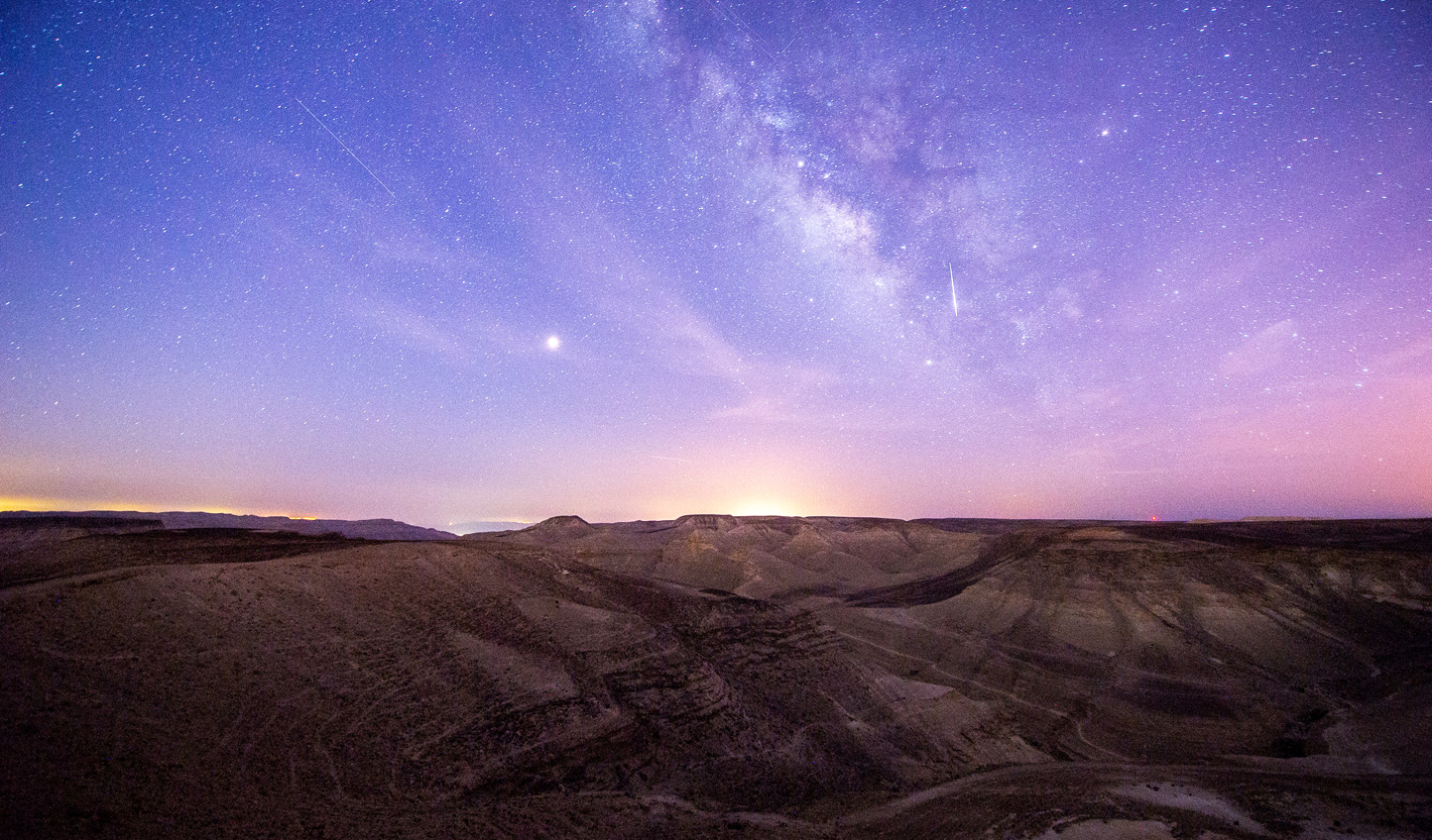 Witness the stars light up the desert skies by night