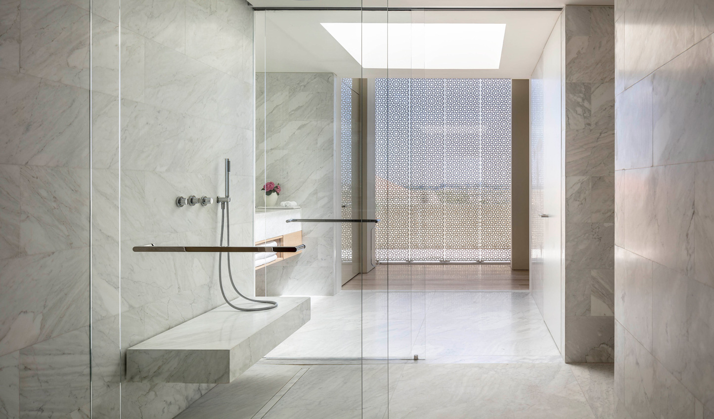 Minimalist marble bathrooms perfectly counteract both the contemporary and historic rooms