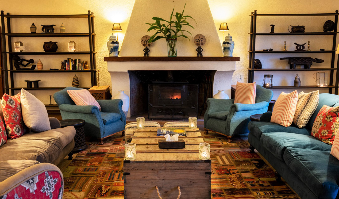 Snuggle up at the end of a day of trekking by the cosy fireplace