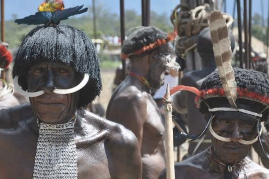 An unusual holiday: meet members of the Dani Tribe